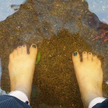 bare feet in flood waters