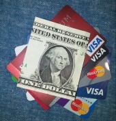 Credit cards and a dollar bill