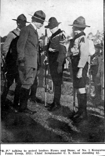Lord Baden-Powel talking to patrol leaders Byers and Done, of No. 1 Kangaroo Point troop, 1911; Chief Scoutmaster C. S. Snow standing by