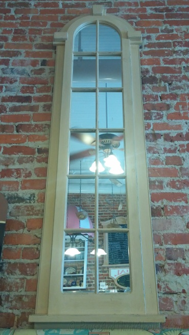 A mirror inside of a local bakery. Very charming, indeed.